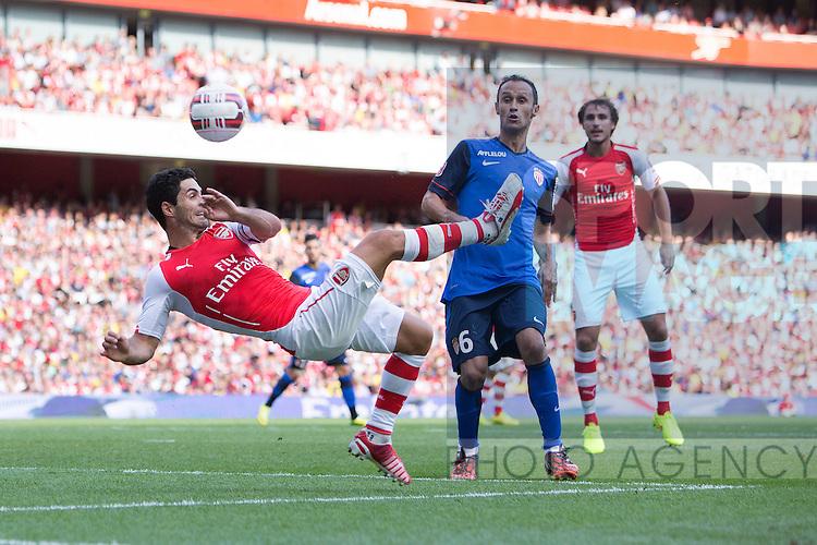Arsenal's Mikel Arteta tries an overhead kick towards goal - Arsenal vs. Monaco - Emirates Cup - Emirates Stadium - London - 03/08/2014 Pic Philip Oldham/Sportimage