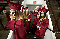 NWA Democrat-Gazette/DAVID GOTTSCHALK  Elizabeth Alfaro (from right), Sonora Haring, Lauren Westbrook and Abigail Wilcox, graduating seniors wave Wednesday, May 17, 2017, from a stairwell at Barnhill Arena before graduation ceremonies of Rogers New Technology High School on the campus of the University of Arkansas in Fayetteville. The graduating class is the first to complete all four years at the school.