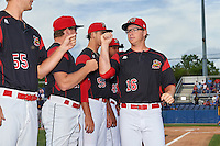 Batavia Muckdogs pitcher RJ Peace (16) fist bumps teammates during introductions before a game against the State College Spikes on June 22, 2016 at Dwyer Stadium in Batavia, New York.  State College defeated Batavia 11-1.  (Mike Janes/Four Seam Images)