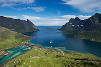 Passenger ferry arrives at isolated village of Vindstad, Moskenesøy, Lofoten Islands, Norway