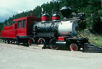 Old fasioned steam train display with cowcatcher,