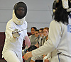 Bridget Strysko of Garden City, left, battles Macy Meng of Great Neck South in an epee bout during a fencing meet at Garden City High School on Saturday, Jan. 9, 2016. Strysko won the bout 5-4.