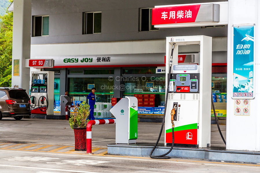 Guizhou, China, between Zhaoxing and Kaili.  Gas Station with Refreshment Store.