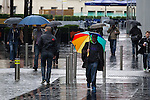 © Joel Goodman - 07973 332324 . 06/09/2013 . Manchester , UK . Commuters raise their umbrellas on the rainsoaked streets of bleak, cloudy Manchester this morning (Friday 6th September 2013) . Rainy weather spells the end of summer in Manchester . Photo credit : Joel Goodman