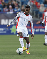 New England Revolution midfielder Clyde Simms (19) at midfield.   In a Major League Soccer (MLS) match, Sporting Kansas City (blue) tied the New England Revolution (white), 0-0, at Gillette Stadium on March 23, 2013.