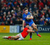 28th December 2019; Thomond Park, Limerick, Munster, Ireland; Guinness Pro 14 Rugby, Munster versus Leinster; Conor O'Brien of Leinster is tackled by Sammy Arnold of Munster - Editorial Use