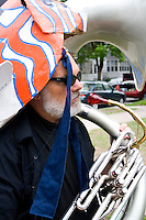 Sousaphone musician and fish puppet representing creatures of the water. MayDay Parade and Festival. Minneapolis Minnesota USA