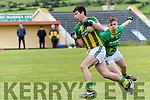 Lios Póil Cathal Ó Súilleabhain in possession of the ball tackled by Castlegregory Patrick O'Donoghue during the West Kerry Championship game at Lios Póil GAA grounds on Saturday evening.