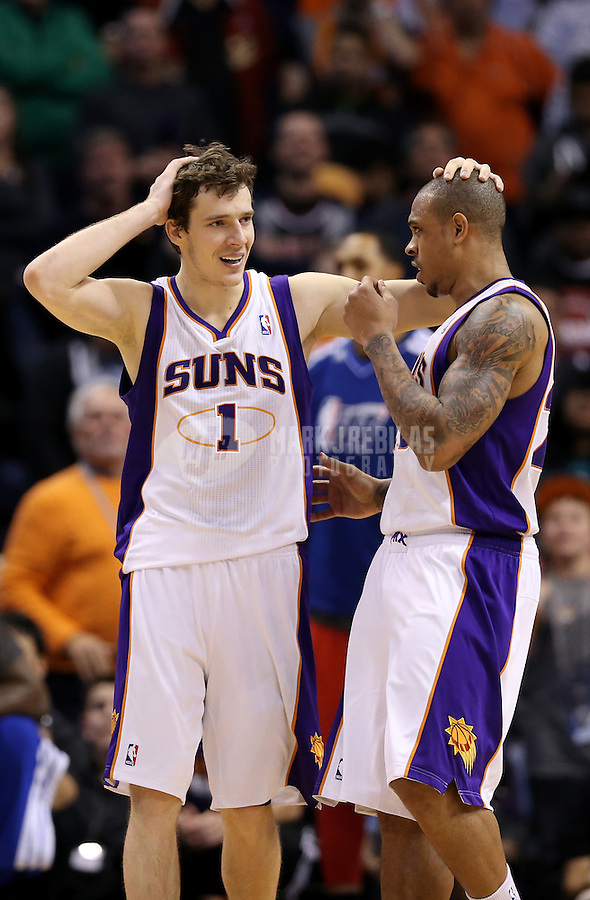 Jan. 24, 2013; Phoenix, AZ, USA: Phoenix Suns guard Goran Dragic (1) celebrates with guard Shannon Brown in the closing seconds of the game against the Los Angeles Clippers at the US Airways Center. The Suns defeated the Clippers 93-88. Mandatory Credit: Mark J. Rebilas-USA TODAY Sports