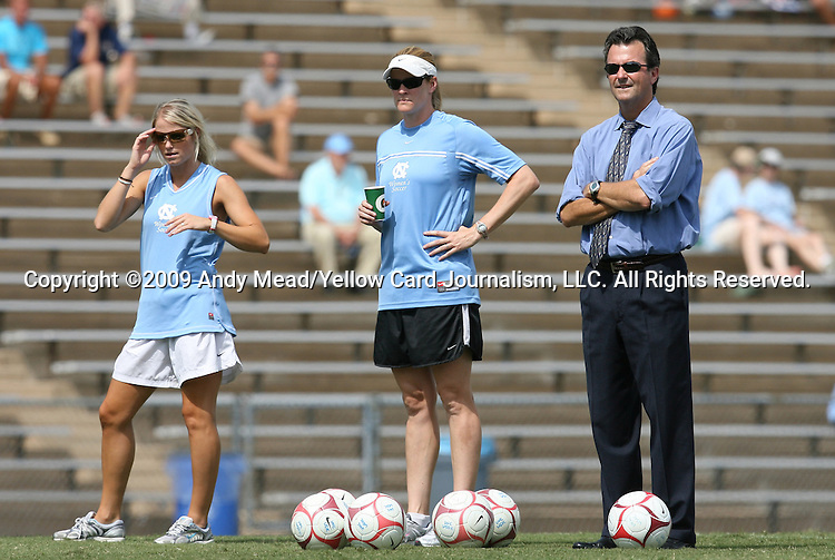 30 August 2009: UNC head coach Anson Dorrance (right) with volunteer assistant coach Cindy Parlow (center) and former player Mandy Moraca (left). The University of North Carolina Tar Heels defeated the University of North Carolina Greensboro Spartans 1-0 at Fetzer Field in Chapel Hill, North Carolina in an NCAA Division I Women's college soccer game.