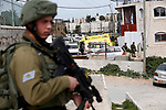 Israeli security forces inspect the scene of an alleged stabbing attack in the West Bank city of Hebron, on March 12, 2019. According to reports, Israeli forces shot and killed a Palestinian who allegedly tried to carry out a stabbing attack on Settlers in Hebron. Photo by Wisam Hashlamoun