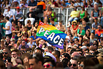 "© Joel Goodman - 07973 332324 - all rights reserved . 03/07/2010 . London , UK . A rainbow flag reading "" PEACE "" is waved above the crowd in Trafalgar Square . Annual London Pride march and demonstration through the centre of London . Photo credit : Joel Goodman"