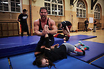 BERLIN 12.2016. FRONT: Toni Tiger Harting<br /> <br /> German Wrestler RAMBO MICHEL BRAUN alias EL COMANDANTE RAMBO during training at GWF Wrestling School in Berlin Neukölln.<br /><br />Other trainers are: Crazy Sexy mike (Hussein Chaer, man with headband) and Ahmed Chaer (man with beard) (Photo by Gregor Zielke)