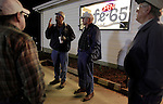 Tobacco farmer John Ashe, second from left, 44, chats with friends Sim Wilson (cq Sim), left, Robert Knight, second from right, and Paul Stone, right, outside of Cafe-65 in Reidsville, NC, early Friday morning, Feb. 24, 2012.  North Carolina tobacco farmers fear they could lose much of their export business because the health industry wants to exclude tobacco products from a major trade agreement with eight Pacific Rim countries.   Photo by Ted Richardson