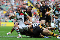 Ross Chisholm is tackled to ground. Aviva Premiership Double Header match, between London Wasps and Harlequins on September 1, 2012 at Twickenham Stadium in London, England. Photo by: Patrick Khachfe / Onside Images
