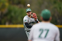 Dartmouth Big Green shortstop Bryce Daniel (4) throws to first base during a game against the Indiana State Sycamores on February 21, 2020 at North Charlotte Regional Park in Port Charlotte, Florida.  Indiana State defeated Dartmouth 1-0.  (Mike Janes/Four Seam Images)