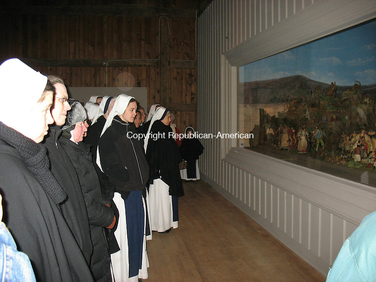 BETHLEHEM, CT - 30 December 2008 - 123008RH02 -Members of the Sisters of Life order based in New York visit the creche at the Abbey of Regina Laudis Tuesday. The order was founded in 1991 to protect and enhance the sacredness of human life.