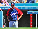 24 July 2011: Washington Nationals Manager Davey Johnson (right) watches play from the dugout during game action against the Los Angeles Dodgers at Dodger Stadium in Los Angeles, California. The Dodgers defeated the Nationals 3-1 to take the rubber match of their three game series. Mandatory Credit: Ed Wolfstein Photo