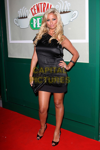 CHANTELLE HOUGHTON.The Central Perk Party to launch the 'Friends' DVD, London, England. .September 23rd, 2009 .full length black silk satin one shoulder dress clutch bag hand on hip plastic surgery.CAP/AH.©Adam Houghton/Capital Pictures.