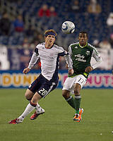 New England Revolution midfielder Pat Phelan (28) attempts to control the ball as Portland Timbers midfielder Jeremy Hall (17) pressures. In a Major League Soccer (MLS) match, the New England Revolution tied the Portland Timbers, 1-1, at Gillette Stadium on April 2, 2011.