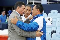 Luis Fernando Suarez (left Honduras coach) greets Maurico Alfaro ElSalvador before the start of the game... Honduras defeated El Salvador 3-2 after extra time to go through to the final at LIVESTRONG Sporting Park, Kansas City, Kansas.
