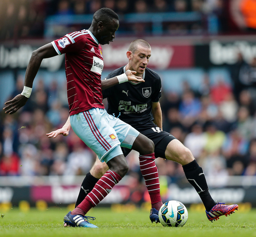 Burnley's David Jones puts pressure on West Ham United's Cheikhou Kouyate<br /> <br /> Photographer Craig Mercer/CameraSport<br /> <br /> Football - Barclays Premiership - West Ham United v Burnley - Saturday 2nd May 2015 - Boleyn Ground - London<br /> <br /> &copy; CameraSport - 43 Linden Ave. Countesthorpe. Leicester. England. LE8 5PG - Tel: +44 (0) 116 277 4147 - admin@camerasport.com - www.camerasport.com