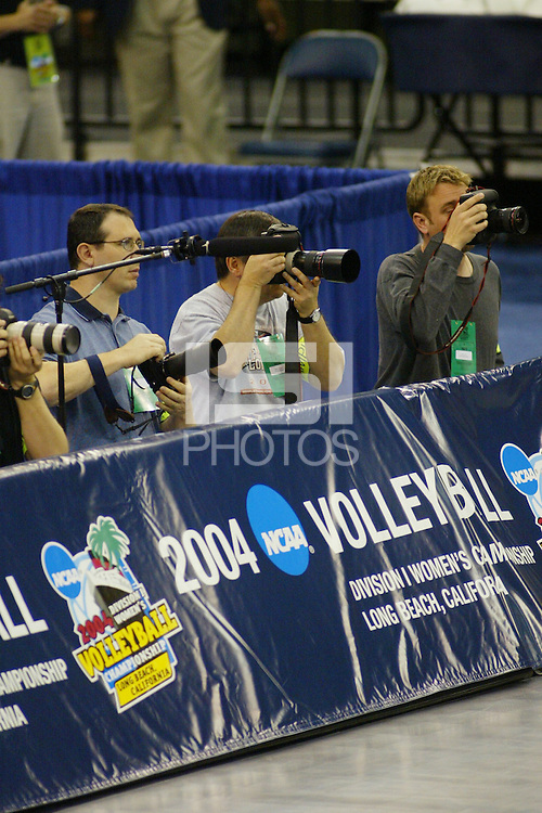 18 December 2004: Photographers during Stanford's  30-23, 30-27, 30-21 victory over Minnesota in the 2004 NCAA Women's Volleyball National Championships in Long Beach, CA. Stanford won their sixth women's volleyball title in school history.