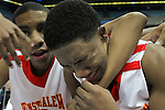 Winston-Salem Prep's Kerry Campbell, right, is overcome by emotion after winning a State Championship and is consoled by teammate Will Tibbs, left,  after the Phoenix beat Plymouth for the title at the Dean Smith Center in Chapel Hill, NC, on Saturday, March 10, 2012.  Photo by Ted Richardson