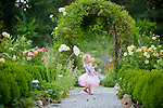 Small girl child playing in tutu in field of flowers