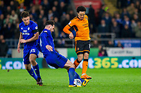 Sean Morrison of Cardiff City tackles Helder Costa of Wolverhampton Wanderers during the Sky Bet Championship match between Cardiff City and Wolverhampton Wanderers at the Cardiff City Stadium, Cardiff, Wales on 6 April 2018. Photo by Mark  Hawkins / PRiME Media Images.