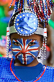 Notting Hill traditionally hosts Europe's biggest street party over the Bank Holiday weekend in August. More than a million spectators lined the carnival route over the two days. Little black girl with a Union Jack painted on her face.