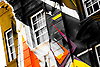 Painted coloured abstract building. Close up of window