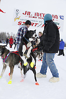 Malinda Tjelta lead dog jumps at the starting line of the 2013 Junior Iditarod start on Knik Lake.  Knik Alaska..Photo by Jeff Schultz/IditarodPhotos.com   Reproduction prohibited without written permission