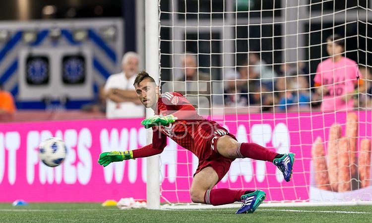 Foxborough, Massachusetts - August 11, 2018: In a Major League Soccer (MLS) match, Philadelphia Union (white) defeated New England Revolution (blue/white), 3-2, at Gillette Stadium.<br /> Penalty kick goal.