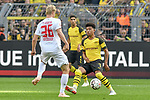 06.10.2018, Signal Iduna Park, Dortmund, GER, DFL, BL, Borussia Dortmund vs FC Augsburg, DFL regulations prohibit any use of photographs as image sequences and/or quasi-video<br /> <br /> im Bild v. li. im Zweikampf Martin Hinteregger (#36, FC Augsburg) Jadon Sancho (#7, Borussia Dortmund) <br /> <br /> Foto &copy; nph/Horst Mauelshagen