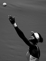 Venus Williams tosses the tennis ball to serve during play in the Bausch & Lomb Championships at Amelia Island Plantation..