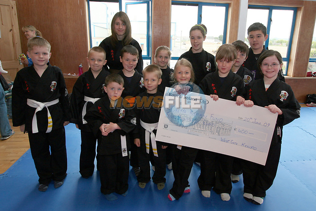Kempo Karate Kids with instructor Anthony O'Connor present cheque to Thomas Cullen and Maria Kieran with Baby Gretta. ..Photo NEWSFILE/Jenny Matthews.(Photo credit should read Jenny Matthews/NEWSFILE)....This Picture has been sent you under the condtions enclosed by:.Newsfile Ltd..The Studio,.Millmount Abbey,.Drogheda,.Co Meath..Ireland..Tel: +353(0)41-9871240.Fax: +353(0)41-9871260.GSM: +353(0)86-2500958.email: pictures@newsfile.ie.www.newsfile.ie.FTP: 193.120.102.198.
