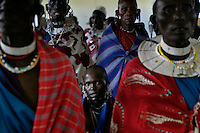 Father Ned's Church in Endulen.  Father Ned is sponsoring 40-50 kids in school.  He figures the only way for Maasai to get their land back is thru education.  Father Ned also has a school for Masai girls.   Maasai in this church (and all of them actually) feel like they are squatters on their land and might be kicked out of the NCA at any time... Just like they were kicked out of Serengeti NP and the crater area of the NCA.  Families cannot cultivate much, can't buy a tractor, can't fence their land etc... etc... because they are in a multi-use area of the NCA. .Father Ned.Endulen.Ned Marchessault.PO Box 42.Ngorongoro Crater.Arusha TZ  East Africa.ned@osotua.org.www.osotua.org.www.pbase.com/nedmarch.255 741 371 331.Because the NCA is a multi-use area and there are many people looking after conservation, but very few involved with social services, the Maasai are caught in the middle.  Rules are incredibly strict in terms of cultivation, firewood and other basics of a pastoral existence.  There are six main communities in the NCA and only two have wells.  The Maasai in this area generally share their water supply with their animals and survive mostly on milk and porridge. ..The migration is like the wild west before they killed all the buffalo.  1.5 million wildebeest are like a train with 200 cars and each car dumps 20 tons of dung a day.  Fertilizer for the entire ecosystem.  Just the saliva from their mouths is enough to keep the grass hydrated...Contact info:.Peter Jones  347 968 6978 USA Mobile.255 744 293 387 TZ Mobile.His email: jones@habari.co.tz  or Ndarakwai@aol.com.http://www.tanzania-safari.com.www.ndarakwai.com.Phone: (255) 27 2502713 .Fax: (255) 27 2508547 .eFax Number: (1) 646 349 3793 .Mobile Phone: +255 744 333550 .Mail:.Tanganyika Film & Safari Outfitters .P.O. Box 49, Arusha, Tanzania, East Africa.Main Contact for entire trip is:.Jombi Herman  Main Fixer, driver, translator. .PO Box 12280.Arusha Tanzania.jambojombi@yahoo.com.+255 (0) 748 32 68 68..E