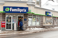 Clients enter a Familiprix drugstore in Quebec city January 4, 2010. Familiprix is a Canadian group of independent pharmacists.