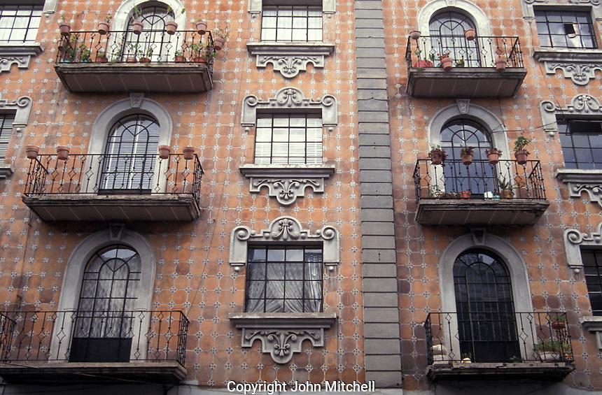 Building facade covered in Talavera tiles in the city of Puebla, Mexico