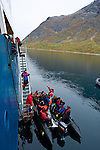 Students from the Cape Farewell Youth Expedition board the zodiac in Greenland's Tasermiut Fjord. The Cape Farewell Youth Expedition was organized by the British Council of Canada.