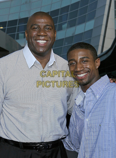 "MAGIC JOHNSON & ANDRE JOHNSON.The Los Angeles Premiere of ""King's Ransom"" held at the Arclight Theatre, Hollywood, CA.April 21st, 2005.Photo Credit: Jacqui Wong/AdMedia.half length father son family .www.capitalpictures.com.sales@capitalpictures.com.© Capital Pictures."