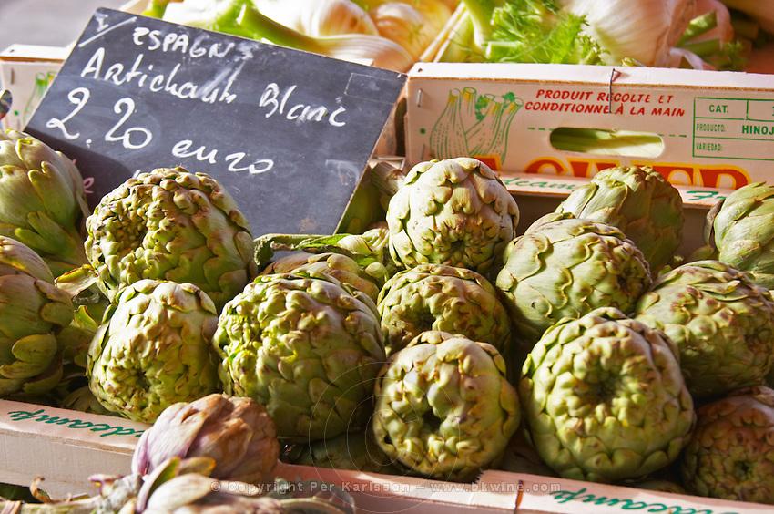 Street market merchant's stall with white artichokes Artichauts Blanc for 2.20 euro Sanary Var Cote d'Azur France