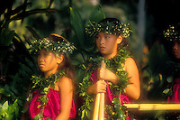 "EDITORIAL ONLY. Children with """"puili"""" (split bamboo), hula implements. Big Island"