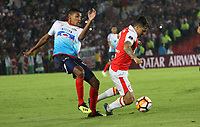 BOGOTÁ -COLOMBIA, 08-11-2018:Diego Guastavino (Der.) jugador de Independiente Santa Fe  de Colombia disputa el balón con Gabriel Fuentes (Izq.) jugador  del Atlético Junior  de Colombia durante primer  partido por la semifinal   de La Copa Conmebol Sudamericana 2018,jugado en el estadio Nemesio Camacho El Campín de la ciudad de Bogotá./ Diego Guastavino (R) Player of Independiente Santa Fe of Colombia disputes the ball with Gabriel Fuentes (L) Player of Atletico Junior of Colombia during the first match for the semifinal of Conmebol Sudamericana Cup 2018, played at the Nemesio Camacho stadium in Bogotá city.Photo: VizzorImage/ Felipe Caicedo / Staff