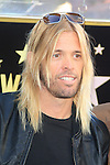 LOS ANGELES - OCT 30: Taylor Hawkins at a ceremony where 'Jane's Addiction' was honored with a star on the Hollywood Walk of Fame on October 30, 2013 in Los Angeles, California