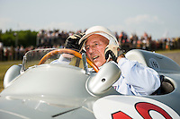 13.07.2013 Chichester, England. Sir Stirling Moss takes a breath as he sits in a 1954 Mercedes-Benz W196 in the top paddock after a run up the hill course during Day 2 of the 2013 Goodwood Festival of Speed in the grounds of Goodwood House.