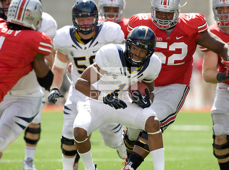 Bryce Treggs of California runs the ball away from Ohio State defenders during the game at Ohio Stadium in Columbus, Ohio on September 15th, 2012.   Ohio State Buckeyes defeated California Bears, 35-28.