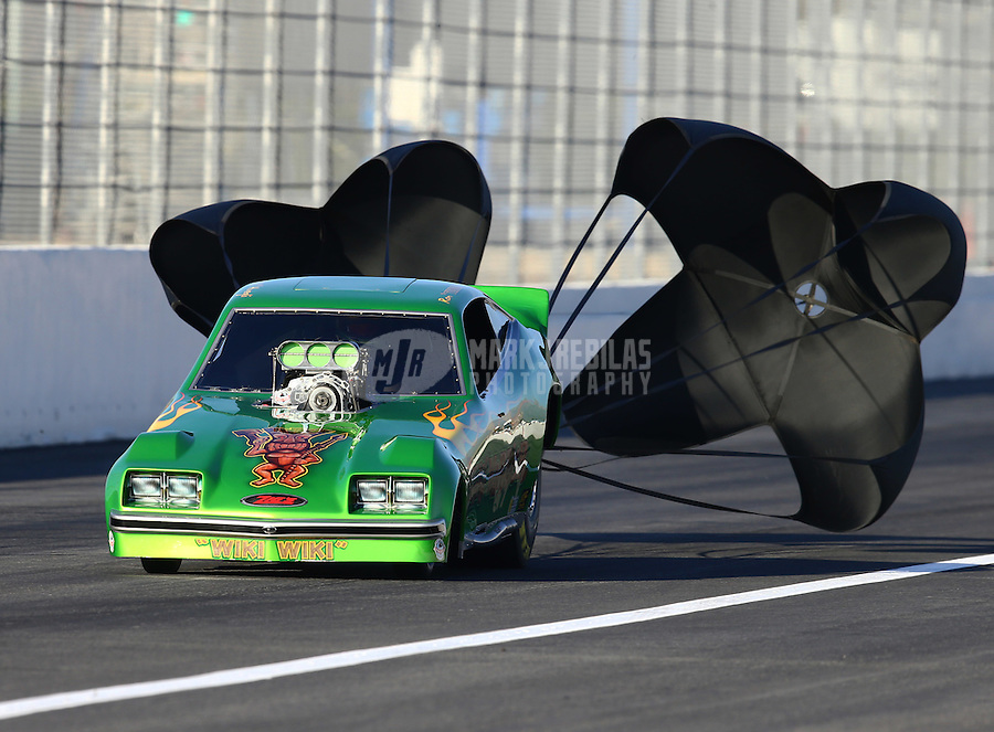 Feb 12, 2016; Pomona, CA, USA; NHRA Ron Huegli in the Tiki Warrior BB funny car during qualifying for the Winternationals at Auto Club Raceway at Pomona. Mandatory Credit: Mark J. Rebilas-USA TODAY Sports