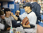 Masahiro Tanaka (Yankees),<br /> APRIL 4, 2014 - MLB :<br /> Masahiro Tanaka of the New York Yankees gets a fist-bump from his teammate in the dugout during the baseball game against the Toronto Blue Jays at Rogers Centre in Toronto, Ontario, Canada. Tanaka made his major league debut in the 7-3 Yankees win. (Photo by AFLO)